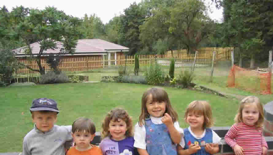 Children posing in the garden